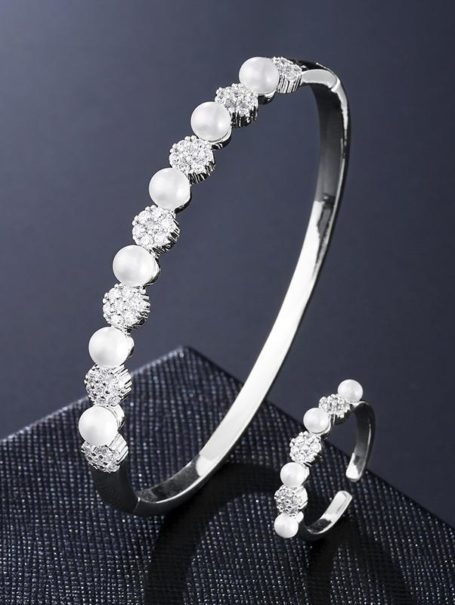 bracelets-floral-jewelled-pearl-bangle-and-open-ring-set-in-white-gold-1